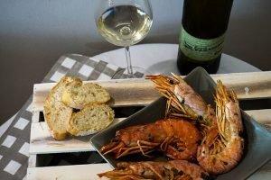 Gambes al forn amb vi blanc Mil Paraules Vinya Escudé